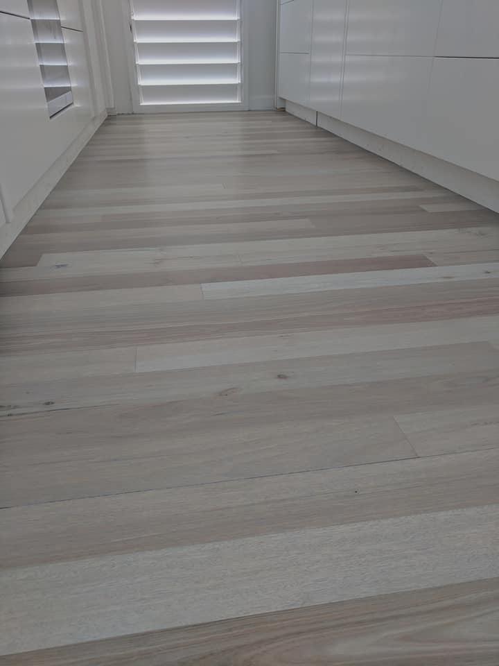 Bleached mixed hardwood room flooring.